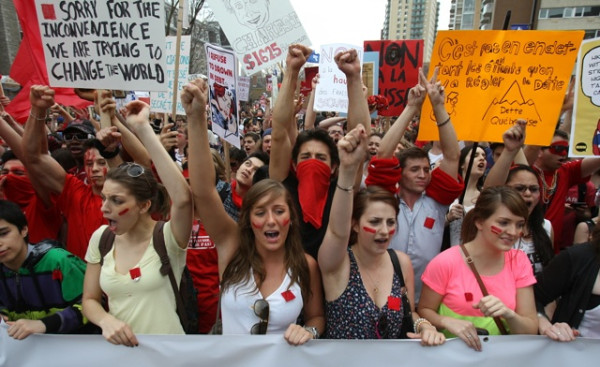The students march along Sherbrooke St to demonstrate against pending tuition increases in Montreal, on Thursday, March 22, 2012.